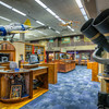 The Emil Buehler Naval Aviation Library<br /> Tucked off to the side in the National Naval Aviation Museum is the Emil Buehler Library. This is the type of room that most men would like to park their desk in and make it their office. With beautiful paintings on the walls, models from the ceiling and other great aviation related items, it says come in and stay awhile.