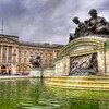 Fountain at Buckingham Palace<br /> Buckingham Palace is the official London residence and main workplace of the British monarch. From the street it appears as a large mansion of sorts. But if you ever see an arial view, you quickly discover that it has a large courtyard, with an even larger rear building section. The east front is famous for Royal Family appearances on the balcony just above the center entrance. In front is the Victoria Memorial with side fountains at the base.
