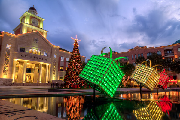 "A Sugar Land Christmas 2012<br /> Three nights ago, I went out to the Sugar Land Town Square with some friends to shoot a few images. This year, the city added ""presents"" in the fountains that light up at night too, adding even more color and reflections. Merry Christmas Sugar Land!"
