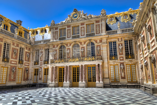 """The Interior Court of the Palace of Versailles<br /> One of the pleasures of owning a home is walking out to the back porch to rest a spell. Away from the noise and traffic of a busy street, it's a place of refuge. There are regular size back porches and then you expand to courtyards. From there they just graduate to """"courts"""". The previous occupants of the Palace of Versailles had no lack of places to relax. How about a court that looked upon almost 50 statutes lining the walls and roofs?  Toss in a little gold ornamentation along the roof and it could almost feel like home."""