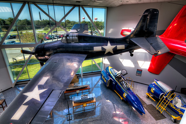 FM-2 Wildcat<br /> This Wildcat hangs in the Quarterdeck st the National Naval Aviation Museum beside the F9F-2 Panther. This shot is perfect for HDR photography, because it allows you to balance the indoor and outdoor exposures.