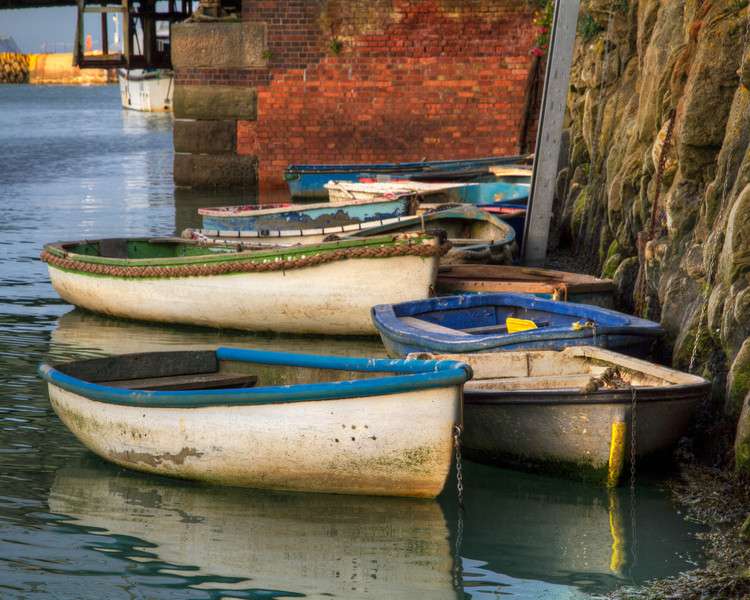 The Rowboats of Folkestone<br /> These rowboats are from the Folkestone Harbor in England, just down the road from Dover. The sun was starting to set and already the little harbor was settling in for the evening.