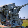 Gun Over Mobile<br /> Going east on I-10 across Mobile Bay, you pass right by the Battleship USS Alabama. Stop. Do not pass Go. Do not collect $200.  Exit now and enter Battleship Memorial Park. This is a great place for the entire family. It's full of history with lots to see, both on and off the ship. There is a hanger with WWII airplanes and the USS Drum submarine. On the grounds you will also see tanks, vehicles, anti-aircraft guns and more. This gun (or cannon) points back to the city of Mobile.