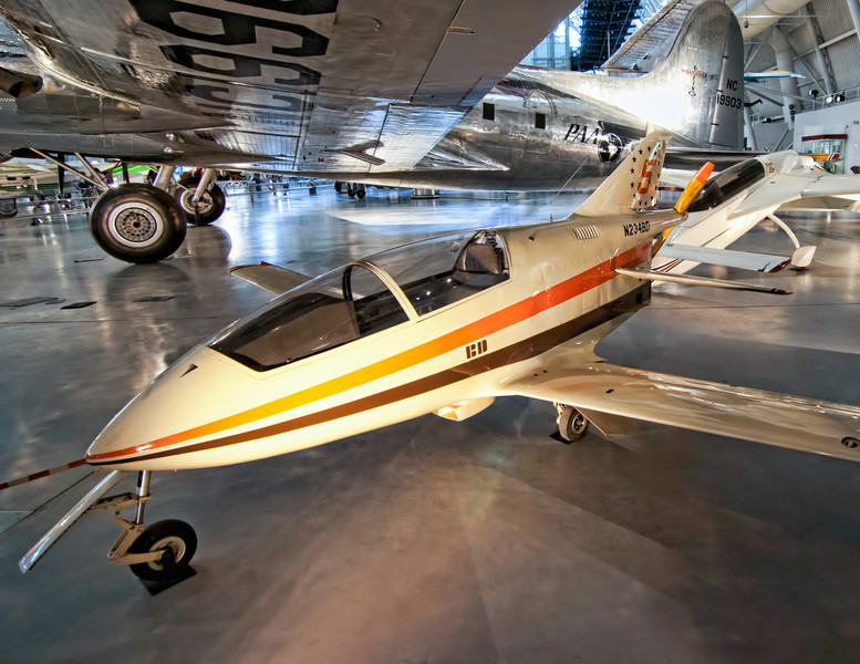 "Bede BD-5B<br /> The BD-5 is a small, single-seat, homebuilt ""kit"" aircraft by the now-defunct Bede Aircraft Corporation in the early 1970s. It has a small, streamlined fuselage holding its semi-reclined pilot under a large canopy, with the mid-engine and propeller mounted immediately to the rear of the cockpit. The BD-5 sold over 5,000 kits or plans.<br /> Only a few hundred BD-5 kits were completed and many of these are still being flown today. There was even a version with a jet engine, like the BD-5J from the James Bond movie Octopuss, now on display in the Pima Air and Space Museum in Arizona. I remember seeing these in magazines as a kid, so it was a treat to view this one sitting under the wing of the Boeing 307 Stratoliner. Both aircraft can be found at the Boeing Aviation Hanger at the Udvar-Hazy Center, part of the National Air and Space Museum."