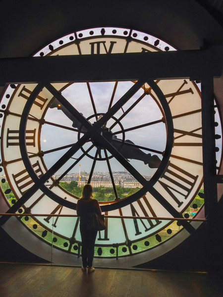 The Museum d'Orsay Clock<br /> A view looking out from the Museum de Orsay in Paris through one of it's two large clocks on the roof.