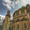 The Sheldonian Theatre<br /> In Oxford, England, you will find a round building called The Sheldonian Theatre. Built from 1664 to 1668, it was named after Gilbert Sheldon, chancellor of the university at the time and the project's main financial backer. Today, it is used for music concerts, lectures and university ceremonies, but not for drama. We skirted by this building on our tour and I meant to go back for a closer look during our very short break. But when you're looking for an ATM so you can buy lunch for the family before getting back on the bus... you get the idea.