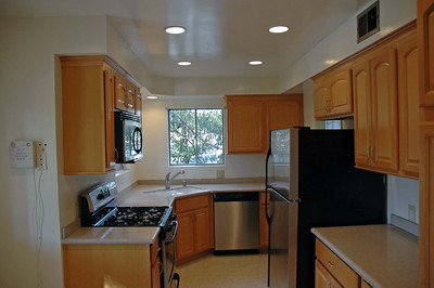 A remodeled kitchen with all Kenmore stainless steel appliances.