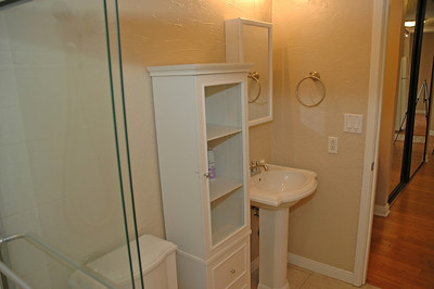 Glass shower stall...pedestal sink...plus storage...