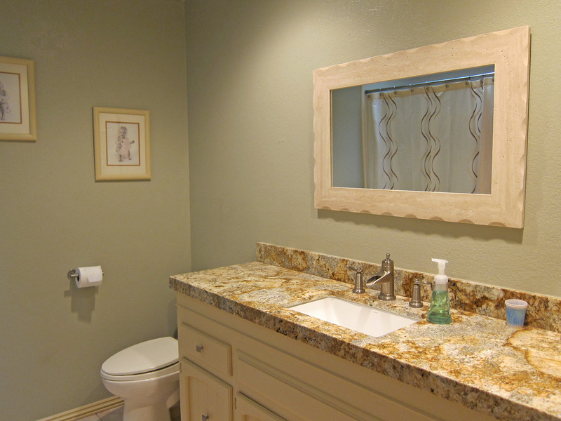 Remodeled hall bathroom with granite counter top. Love the square sink!