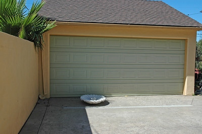 The 2 car garage has a roll-up door and an automatic opener.