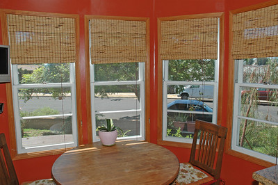 Bay windows make the eat-in kitchen a great place for a morning cup of coffee.
