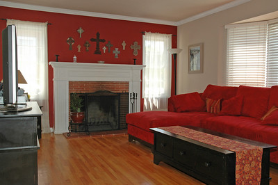 The living room has a fireplace and good natural light.