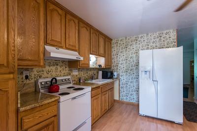Oak cabinets...refrigerator stays...