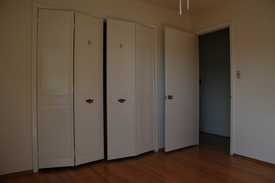 Another view of the first bedroom. The insides of the closets have also been painted.