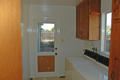 The washer and dryer are conveniently located in the laundry room.