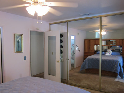 Mirror closet doors and a ceiling fan...