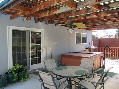 The covered patio can be accessed by the master bedroom or through the patio room...