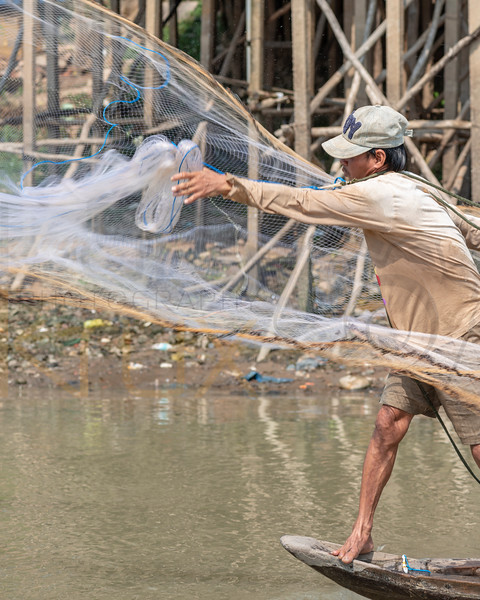 Fisherman on Mekong River, Cambodia