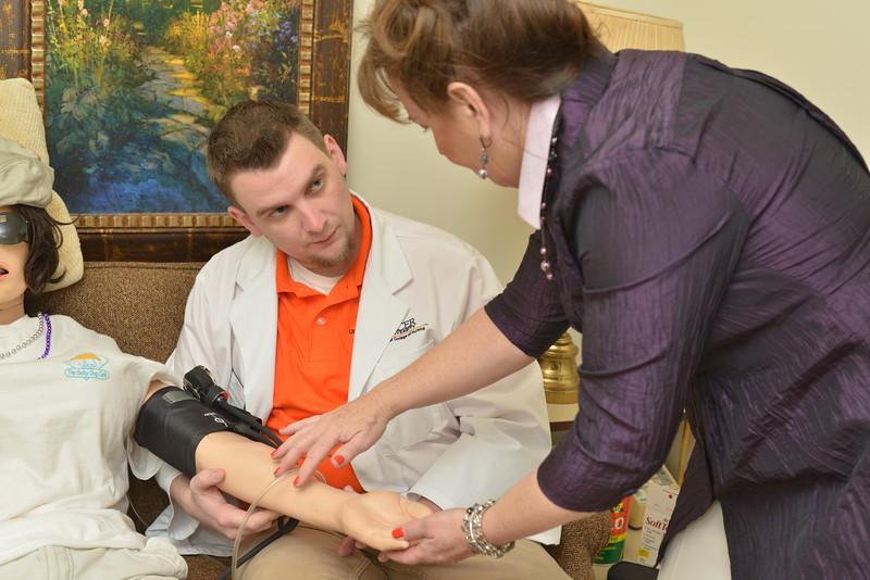 Nursing student learning to take blood pressure