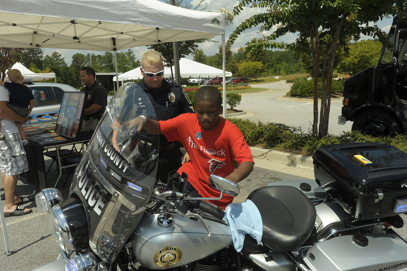 Henry Co Motor Officer B. Labier shows Calvin Durham of Henry County his motorbike