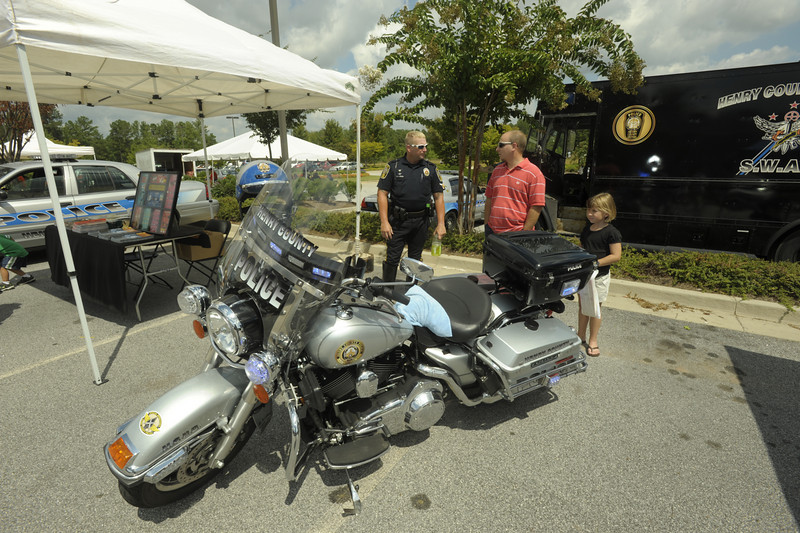 Henry Co Motor Officer B. Labier with Carlos Mendizabol and his daughter Isabella