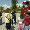 Firefighter/EMT Slagle shows a Henry Co. family how the HCFD ladder truck works