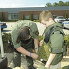 Jake Huggins and his Dad try on henry Co SWAT equipment