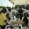Major Langley and Traffic officer Paul Haucharik explain Henry Co. police operations with detra Foster and the Thomas family from Henry co