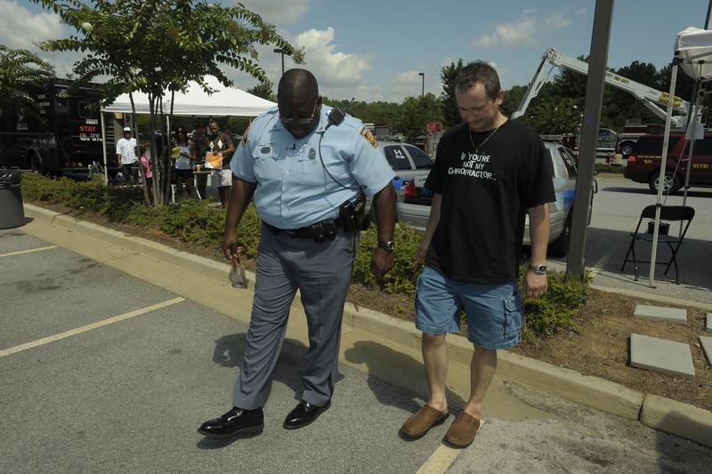 Ga,. State Patrol Tropper Black tests Arek Klos using simulated drunk driving glasses