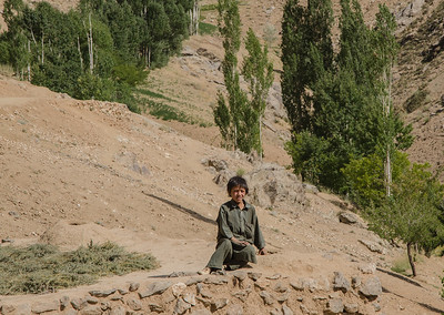 A boy sits outside his house in Ashtarlai district, Daykundi