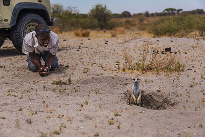 Makgadikgadi Pans, Botswana Our guide waits for a meerkat to come out of its hole.