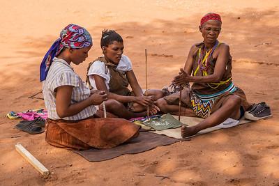 Ghanzi, Botswana San  women making jewelry. They were drilling holes in ostrich shell.