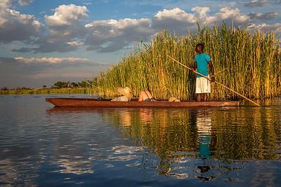 Okavango Delta, Botswana A local poler drives his Makoro Canoe at the Okavango Delta.