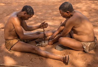 Ghanzi, Botswana A San Bushman starts a fire from scratch at Dqae Qare San Lodge near Ghanzi.