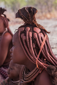 Northern Namibia Himba cover their braided hair and skin with otjize, a mixture of butter fat, ash, and ochre.