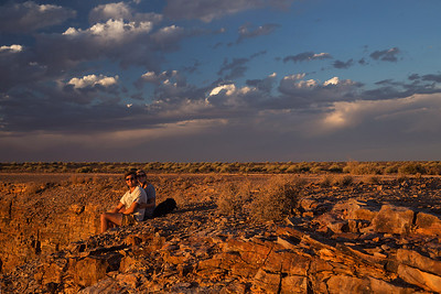 Fish River Canyon, Namibia Henry and Tish sit on the edge of the Fish River Canyon at sunset.