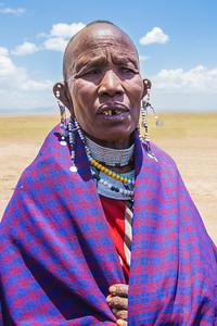 Masai village, Tanzania A Masai man in a village near Serengeti National Park. The Masai men stretch the holes in their ears.
