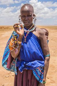 Masai village, Tanzania A Masai woman carries a child in a village near Serengeti National Park.