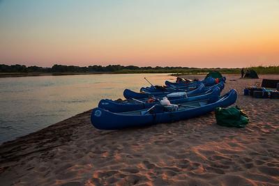 Lower Zambezi River, Zambia Our canoes parked  at sunset on the sandy bank of the lower Zambezi River.