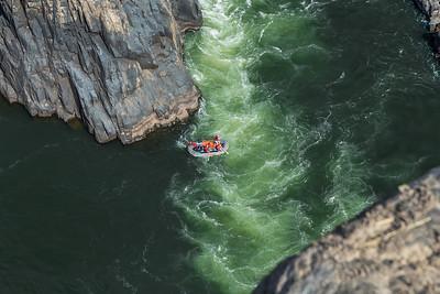 "Victoria Falls, Zambia A raft exits the ""Boiling Pot"" into First Gorge at Victoria Falls."
