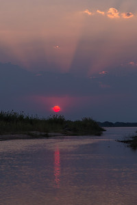 Lower Zambezi River, Zambia A peaceful sunset on the Zambezi River.