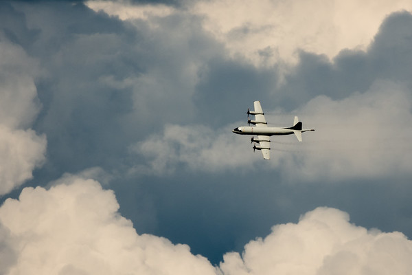 Lockheed P-3C Orion flying through the clouds