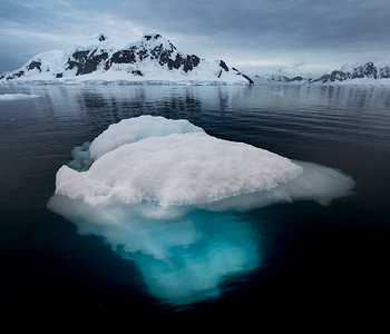 Antarctica: It is hard to describe the beauty of being up close to icebergs in the Antarctic. They are a beautiful bright turquoise color underneath the surface that gently fades off into the dark depths of the crystal clear water below.