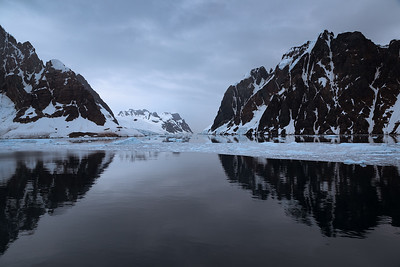 Antarctica: We sailed through calm waters as we entered the narrow Lemaire Channel on a cold and icy morning.
