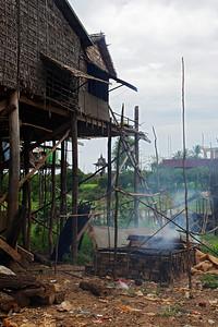 near Tonlé Sap Lake, Cambodia A grill smoking fish in the fishing village near Tonlé Sap Lake.