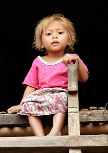 """near Tonlé Sap Lake, Cambodia A kid in the fishing village near Tonlé Sap Lake. I was surprised by her blonde hair and wondered where those genes came from, but I was told that her parents died her hair so she would look more """"western""""."""