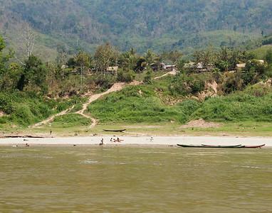 northern Laos Midland hill tribe village (Khmu Tribe), along the Mekong River, northern Laos.