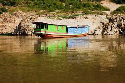 northern Laos A liveaboard boat on the Mekong.