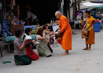 Pak Beng, Laos Monks receiving alms in Pak Beng.