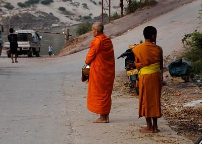 Pak Beng, Laos Monks waiting for early morning alms in Pak Beng.